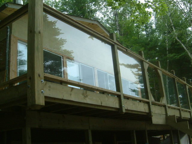 glass and wood deck railing