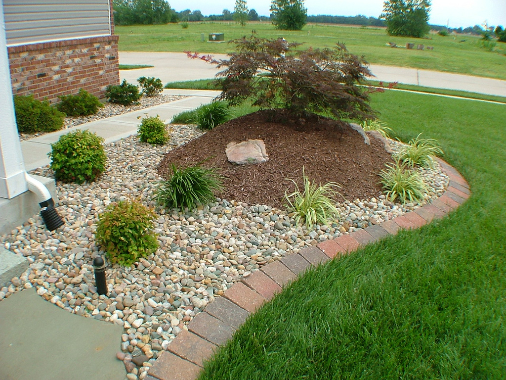 landscaping with rocks and shrubs