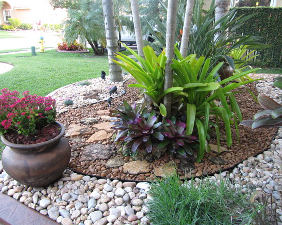 landscaping with rocks in front yard  photo - 1