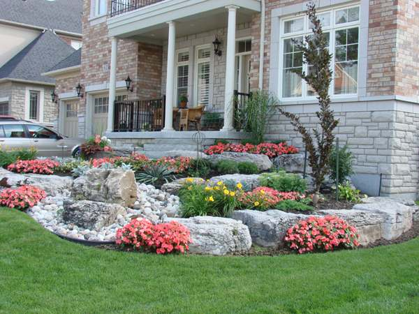 landscaping with rocks in front yard  photo - 2