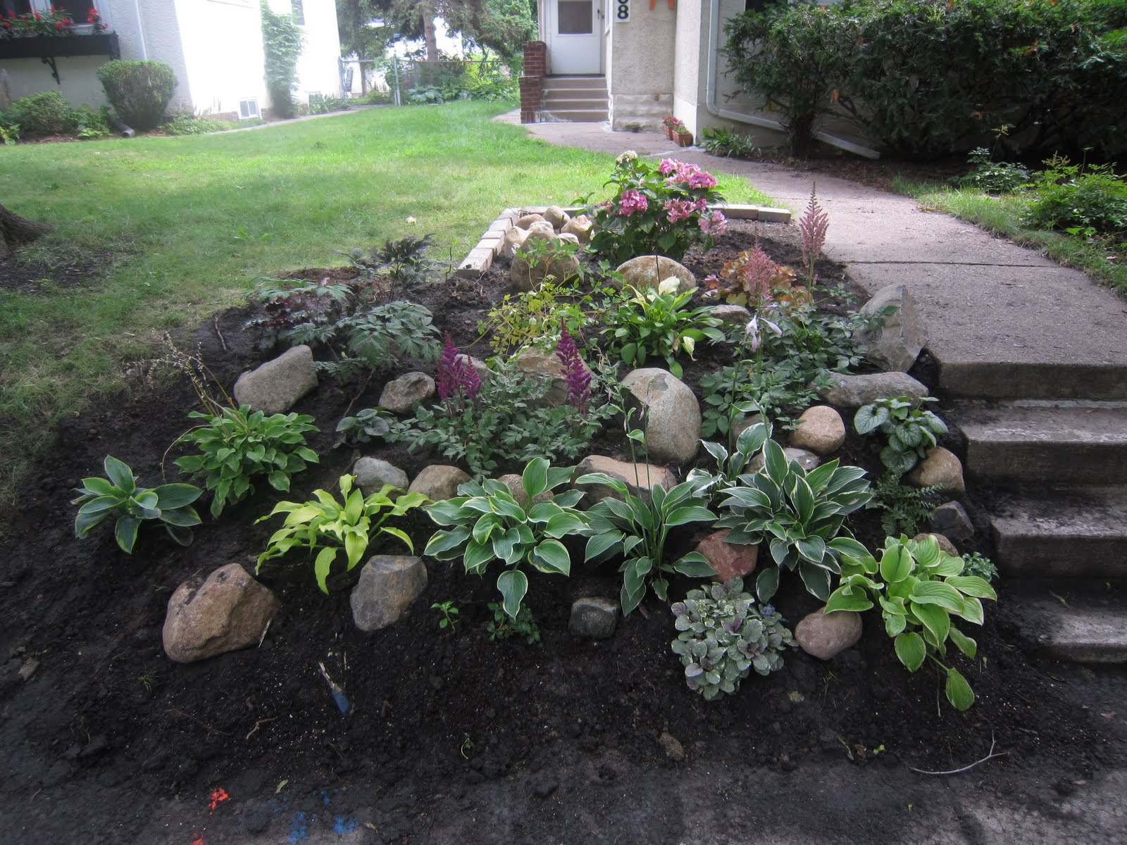 landscaping with rocks on a hill photo 2 - Garden Ideas On A Hill
