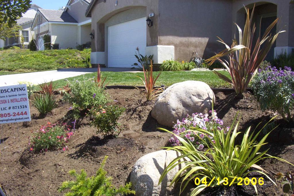 low maintenance landscaping on a slope  photo - 2