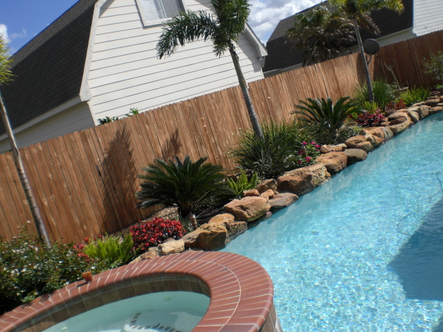 Simple landscaping ideas around a pool design and ideas for Pool garden ideas