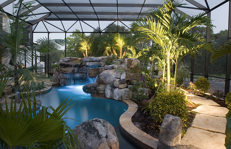tropical plants landscaping around pool